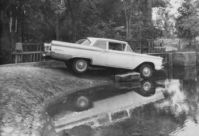 Car near pond