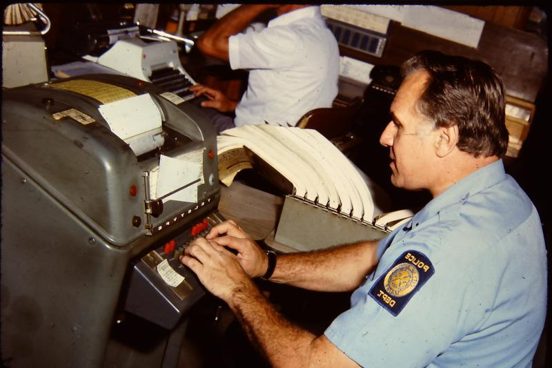 Officer using the teletype machine