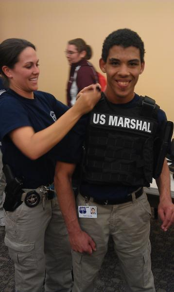 Trying on US Marshal Gear